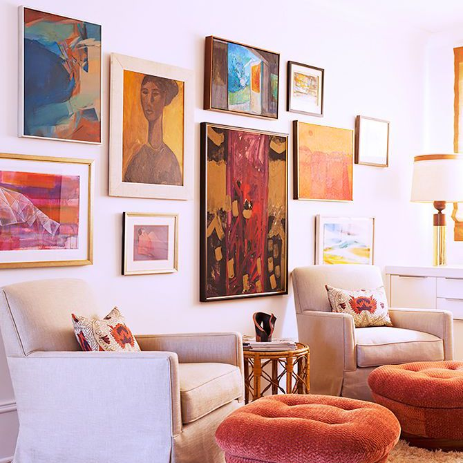 Colorful contemporary and vintage spaces adorn an office in Rucker home, framed art flank both walls