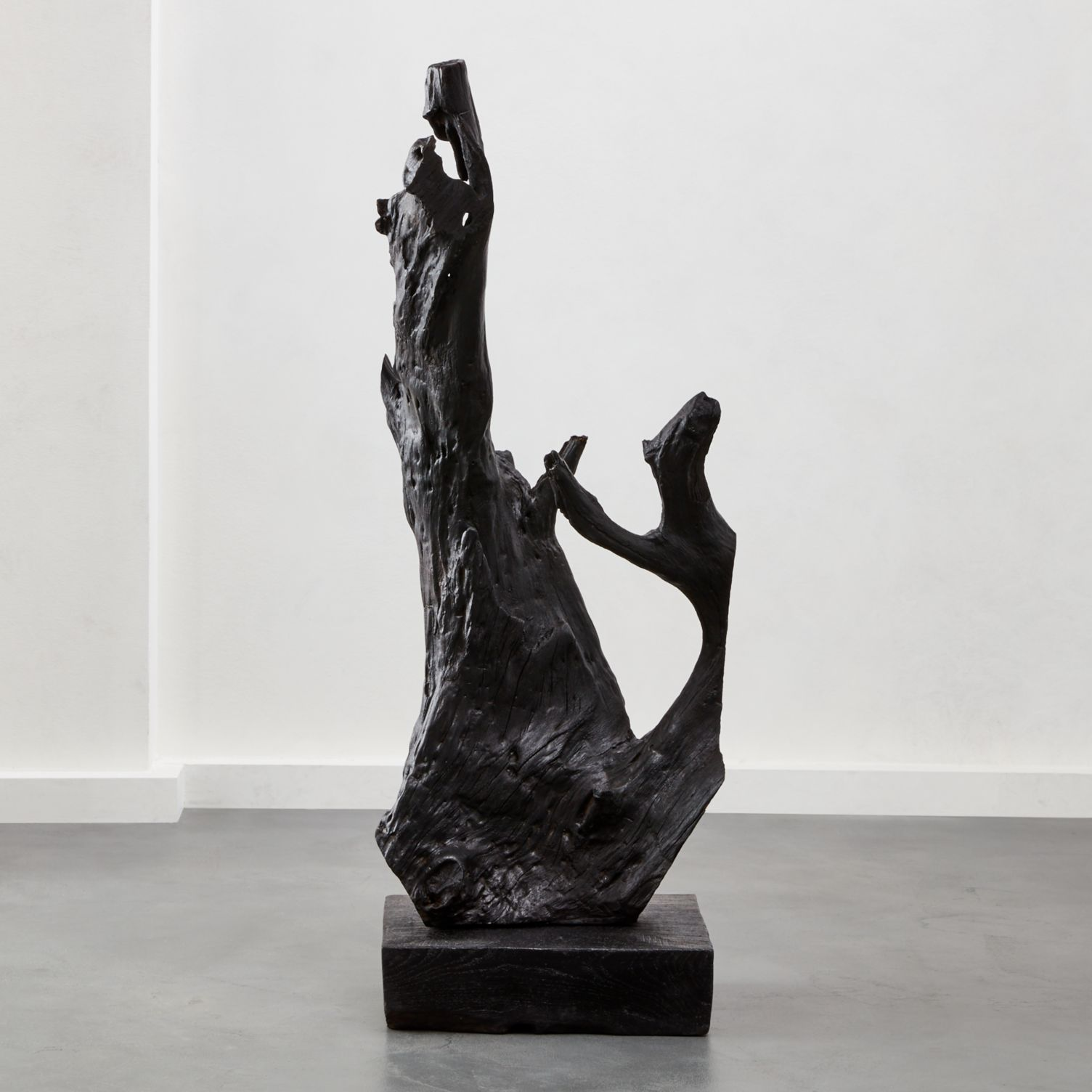 A charred teak root standing sculpture by CB2.
