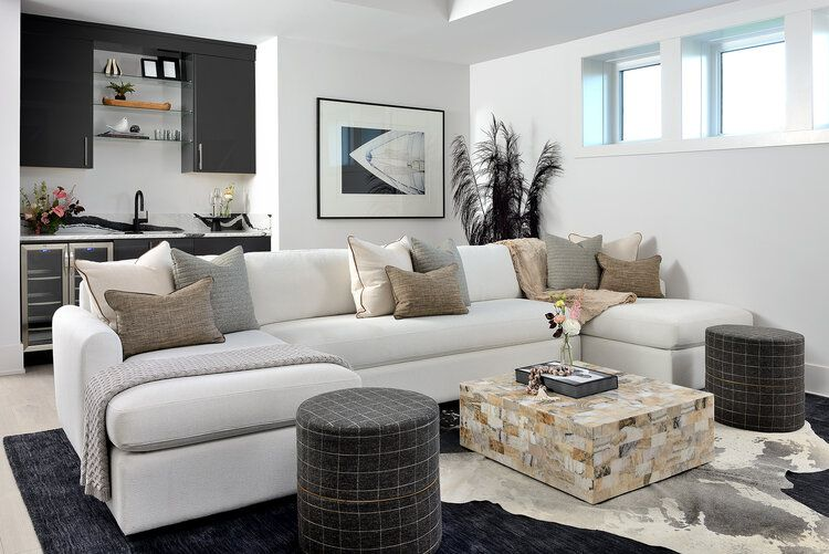 off white couch in bright living room with black accents