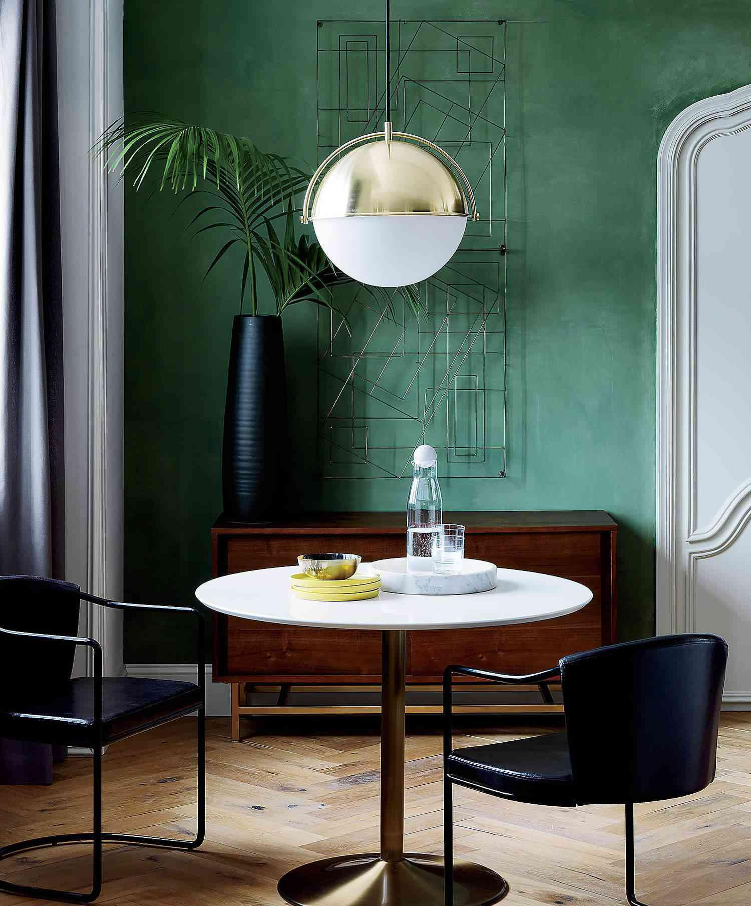 A pendant light hanging over a dining table