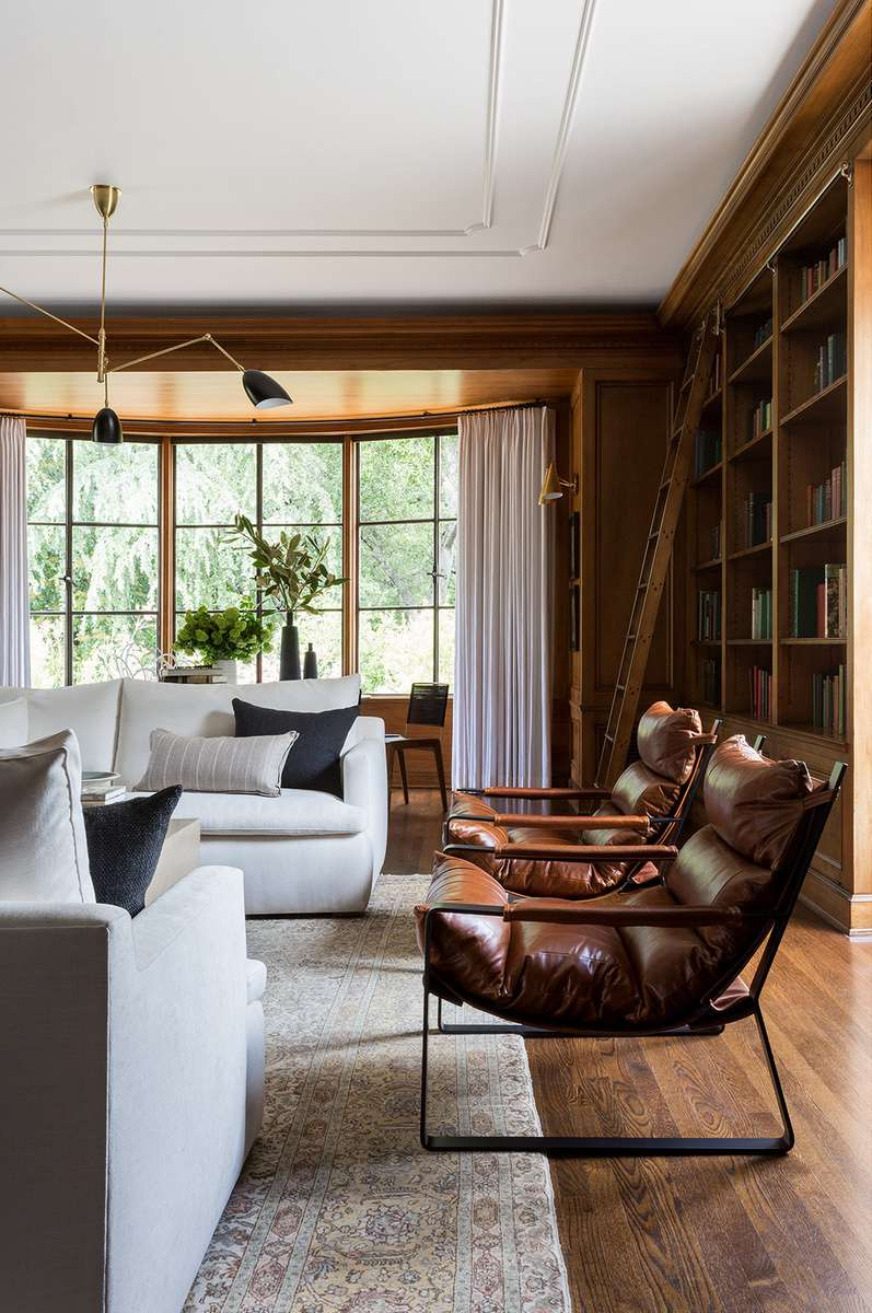 Cozy living room library with wood paneling