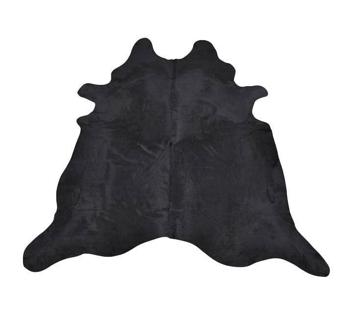 A black cow hide rug, currently for sale at Pottery Barn