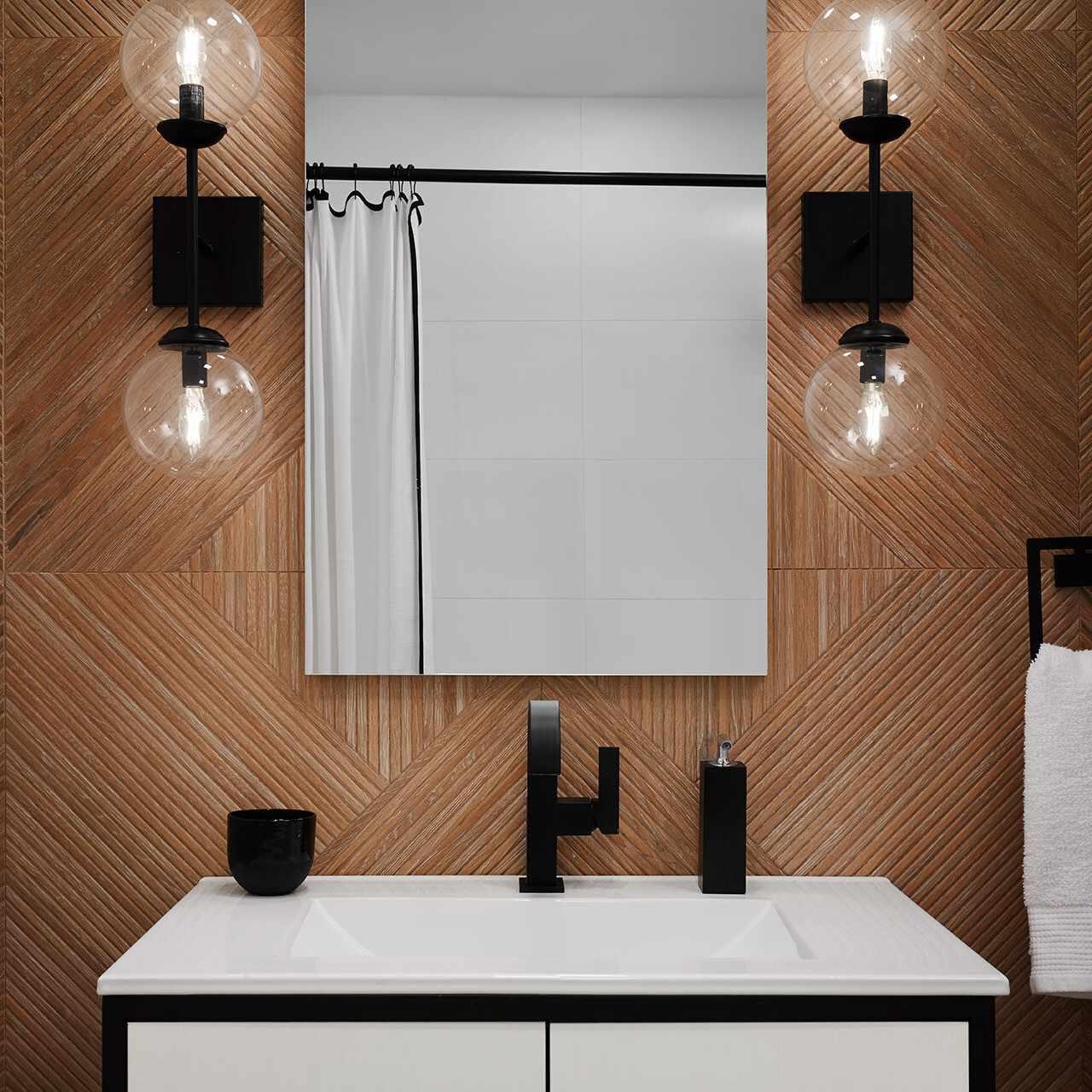 A powder room with wood-paneled walls