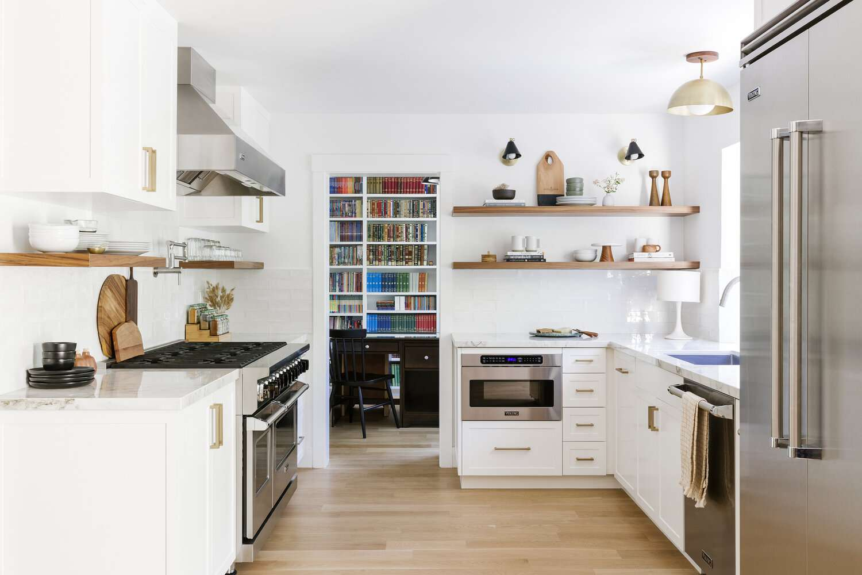 Cathie Hong Interiors bright white kitchen with bookshelf.