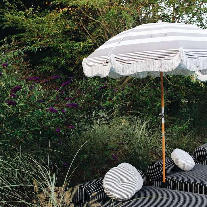 Organic landscaping next to umbrella.