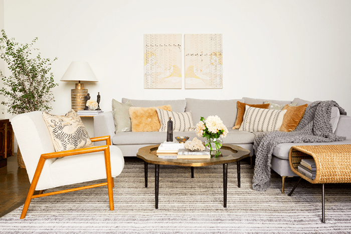 Cozy living room with textural pillows, rug, and blankets