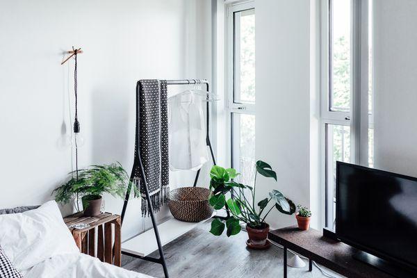 Clothing rack in a minimal bedroom