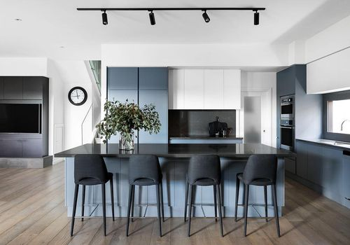 Modern blue and black kitchen with track lighting fixtures