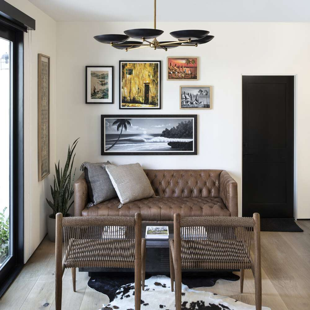 Small seating area with loveseat and extra chairs