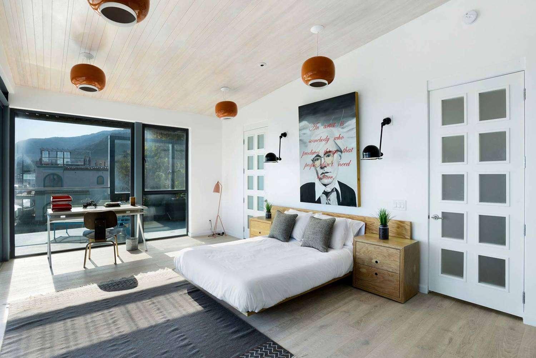 White bedroom with grid closet door.