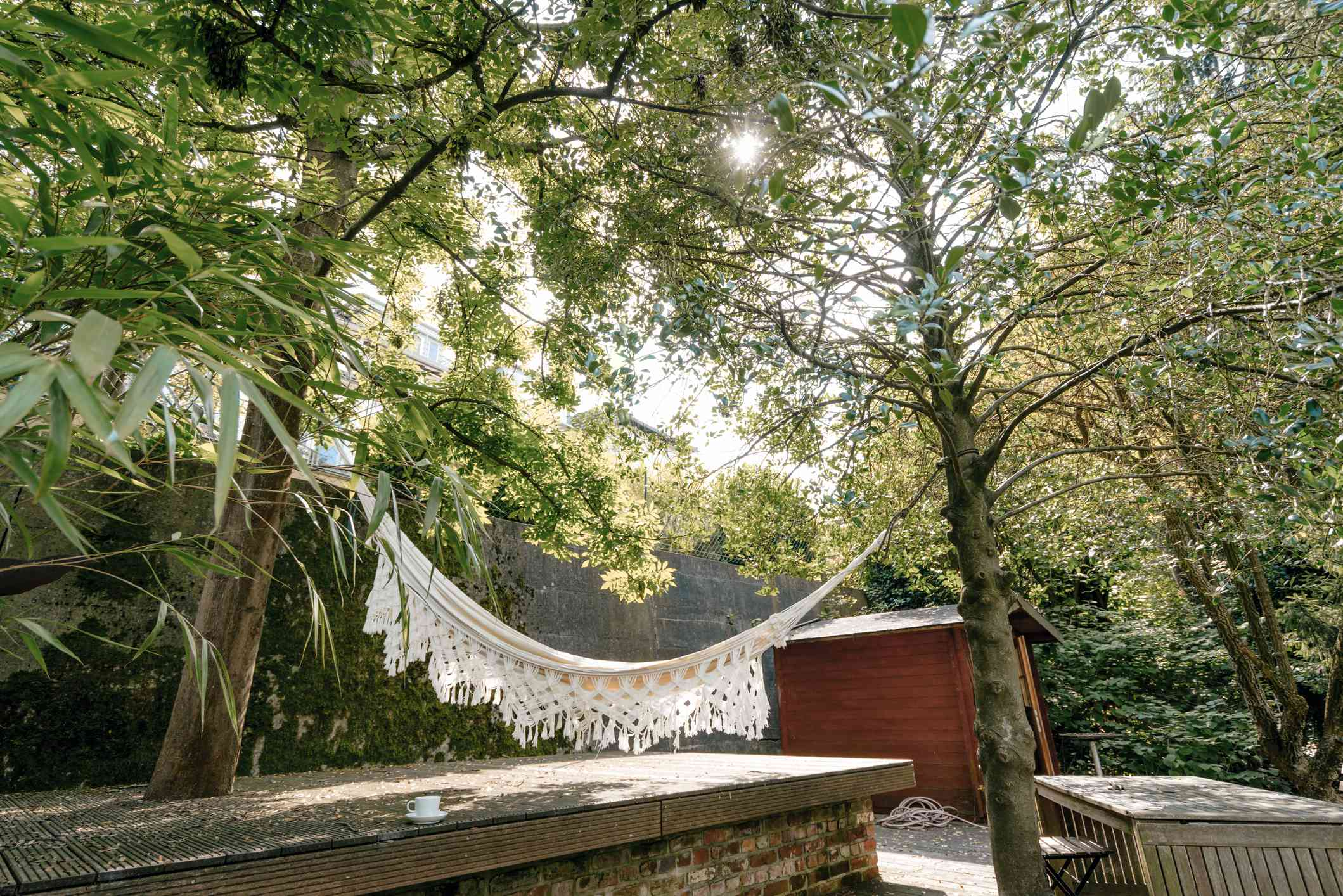 A hammock hanging between two trees.