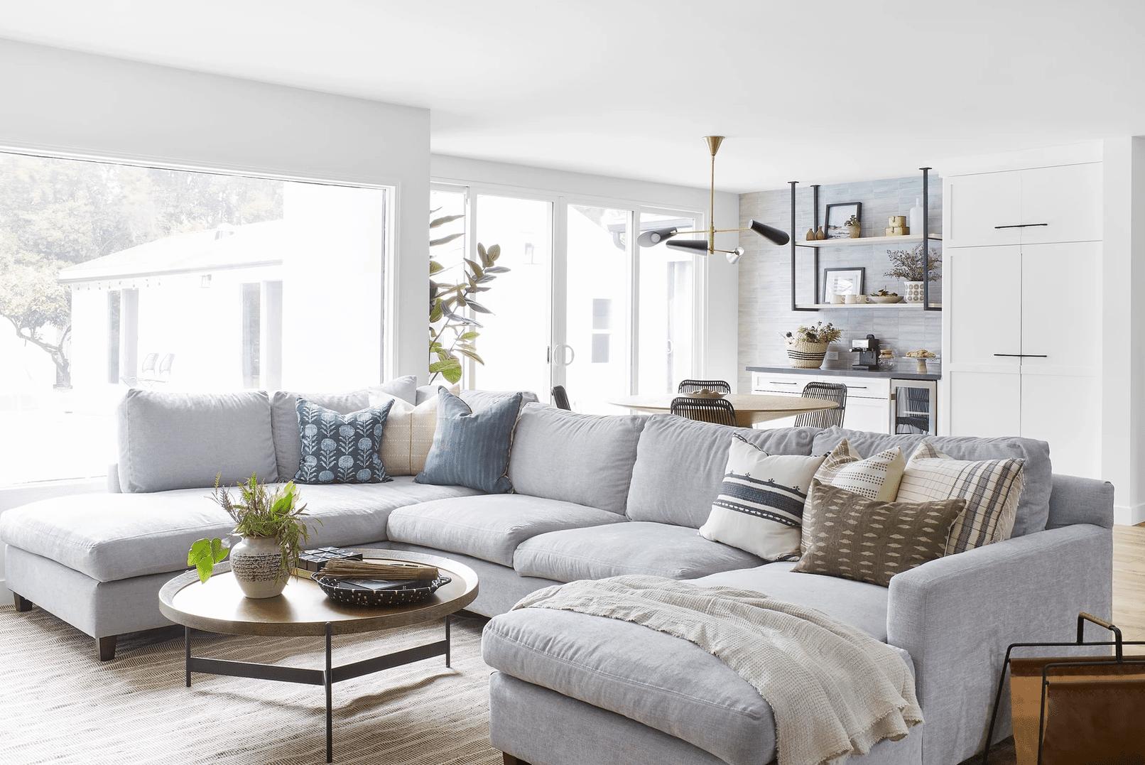 Large light grey sectional sofa.