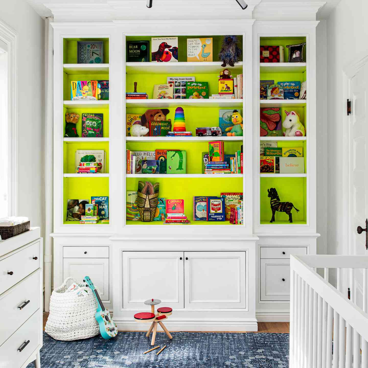 A large white built-in in the kids bedroom.