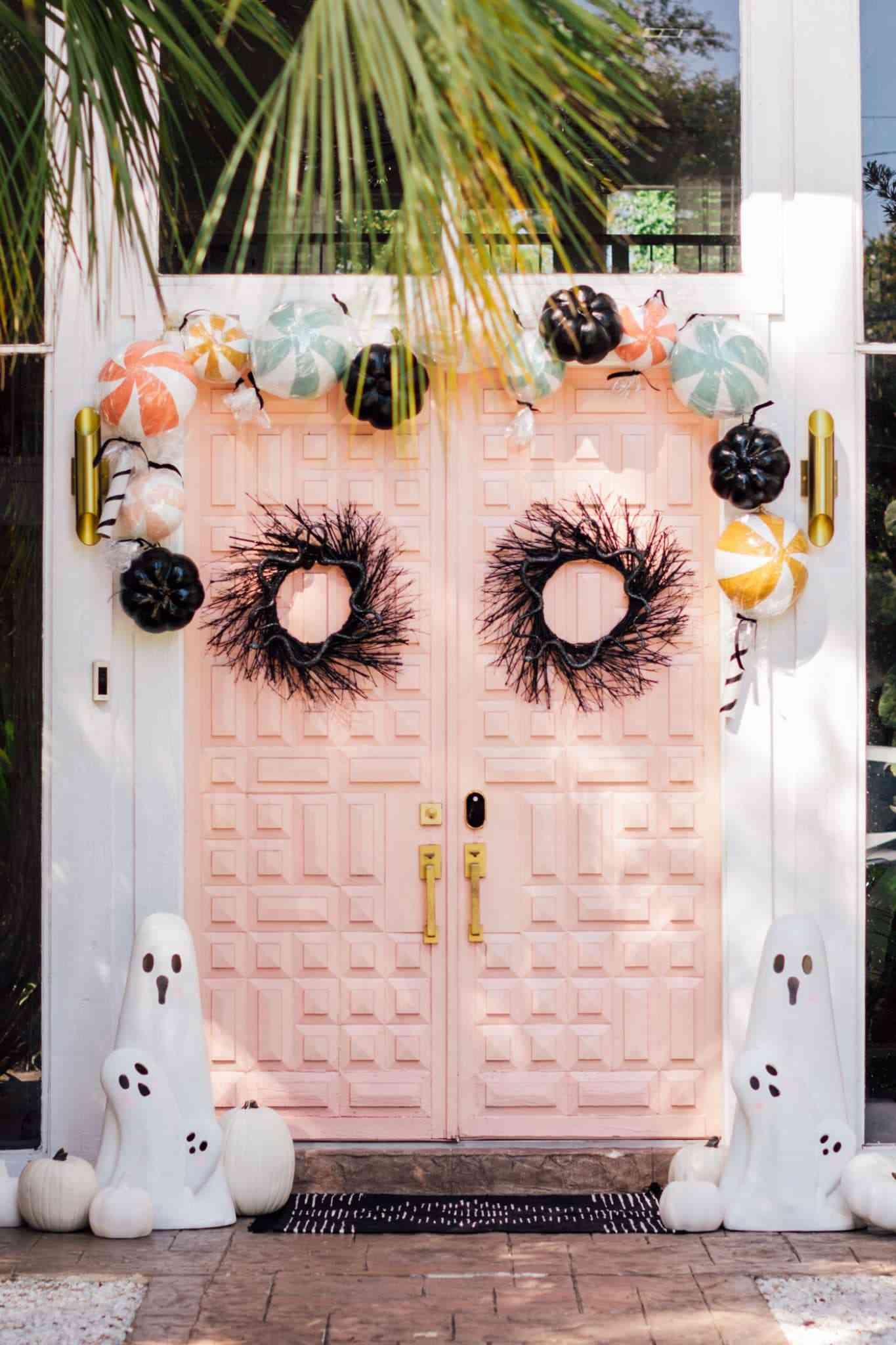 Pink door with halloween decor