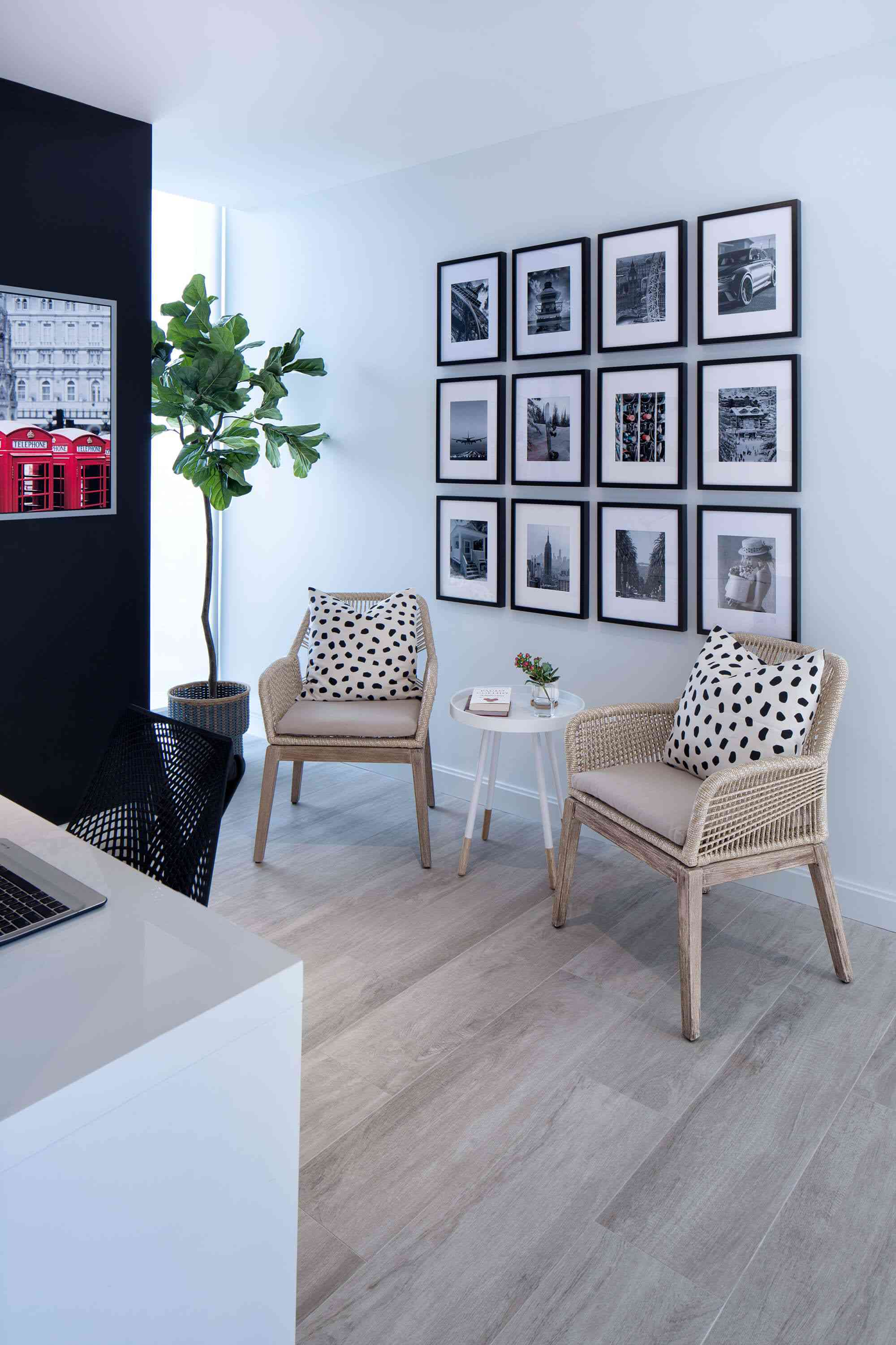 Seating area with clean black and white gallery wall
