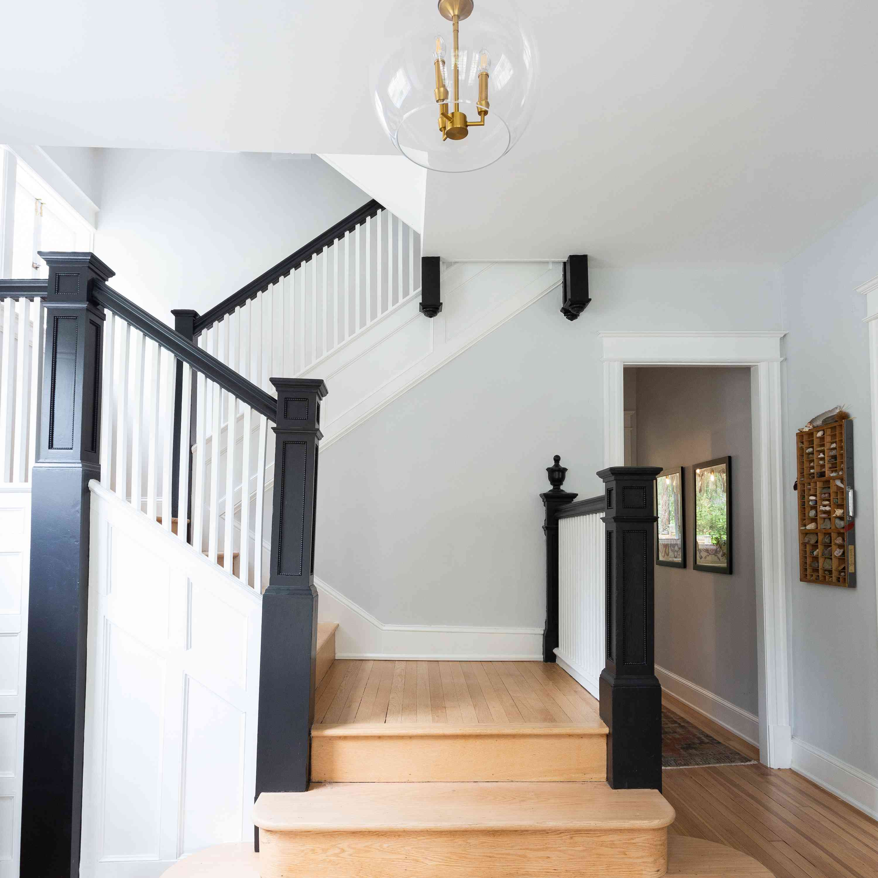 Front entry staircase with natural wood floors.