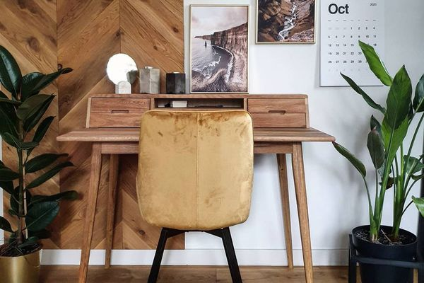 moody home office with wood desk