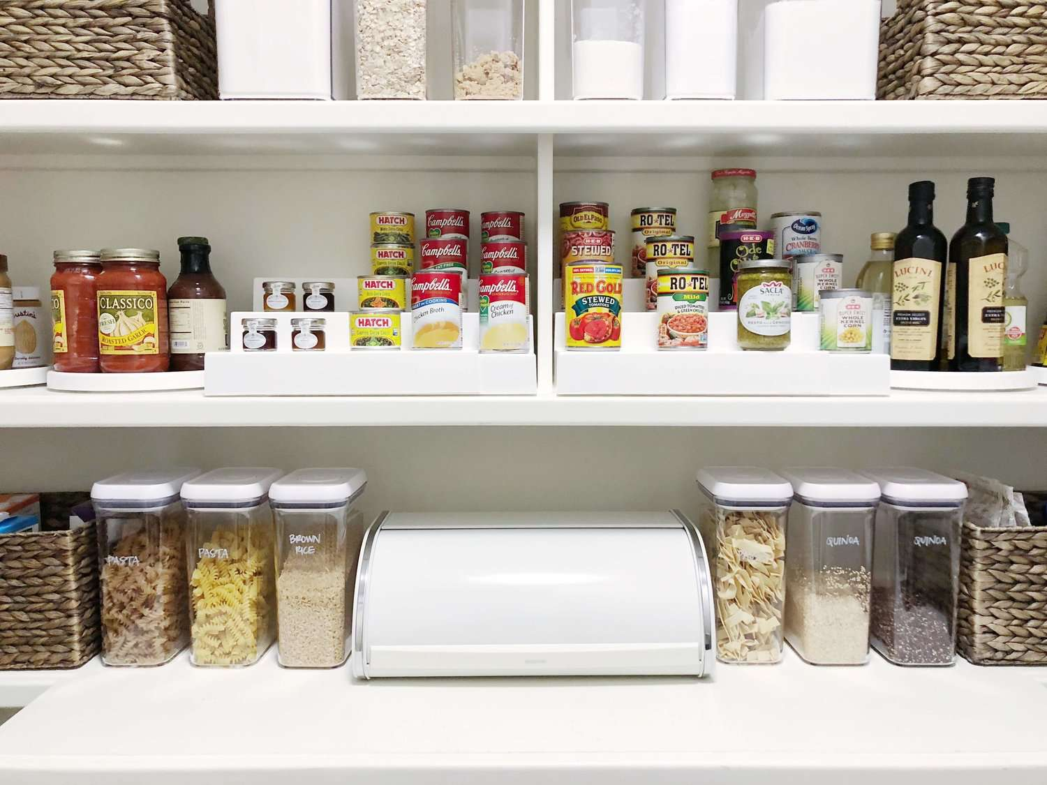 Organized pantry with containers holding cereal and pasta.