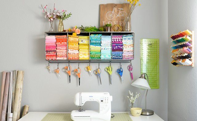 A craft room with color-coordinated fabric swatches and scissors