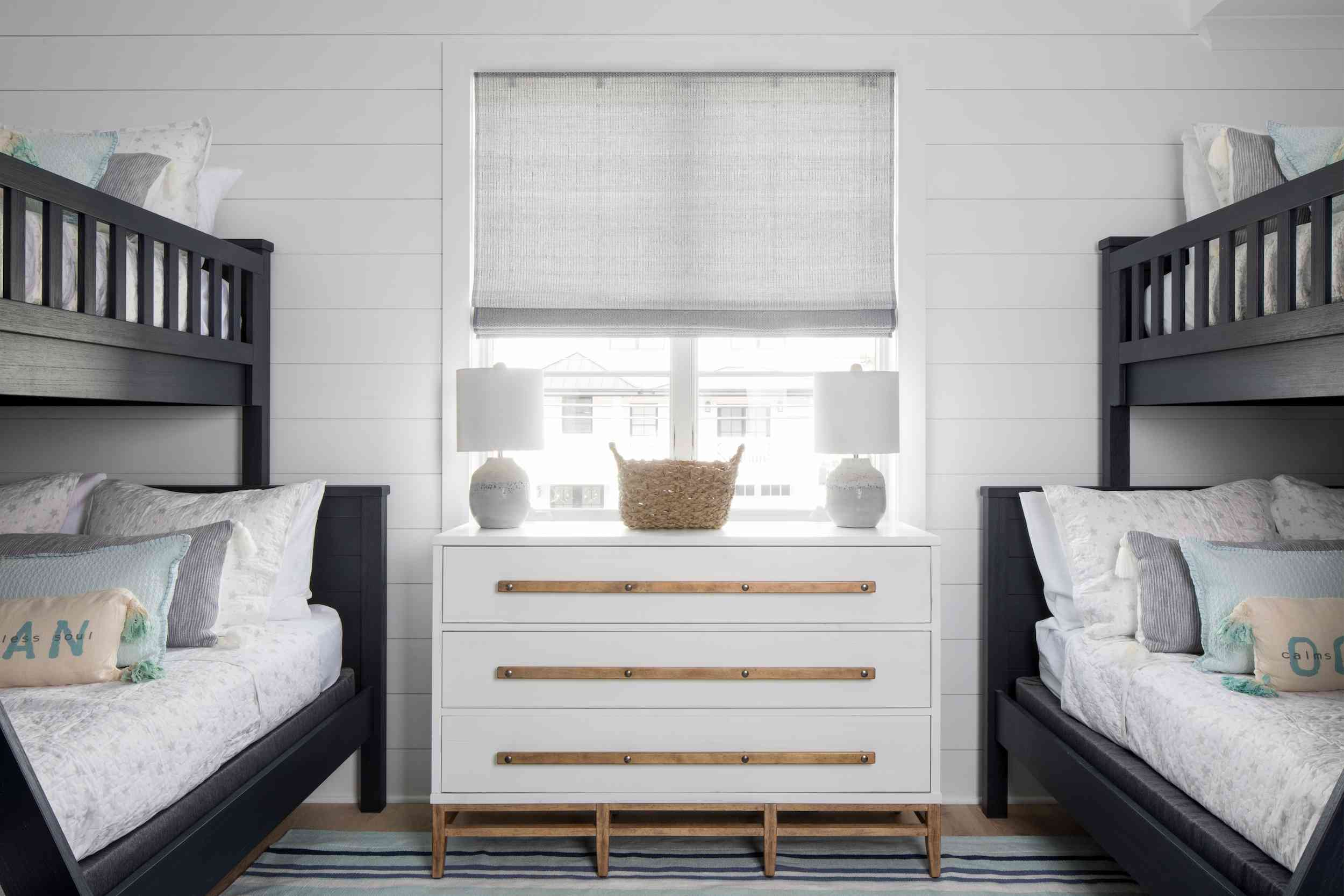 Paneled room with bunk beds