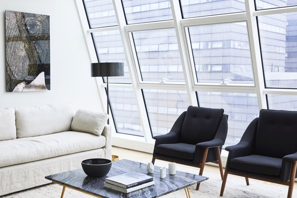 Den with large bay windows by ASH NYC