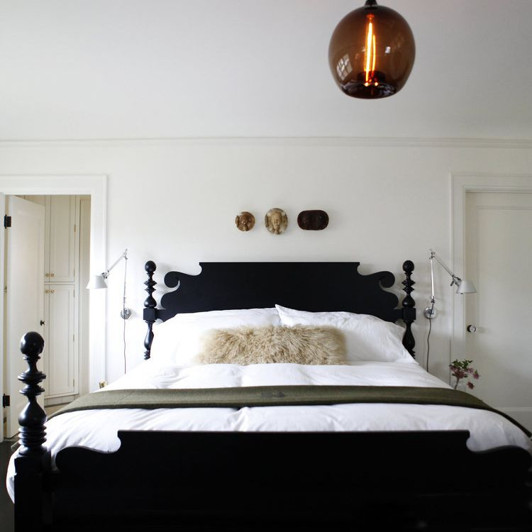 A bedroom with a large antique bed