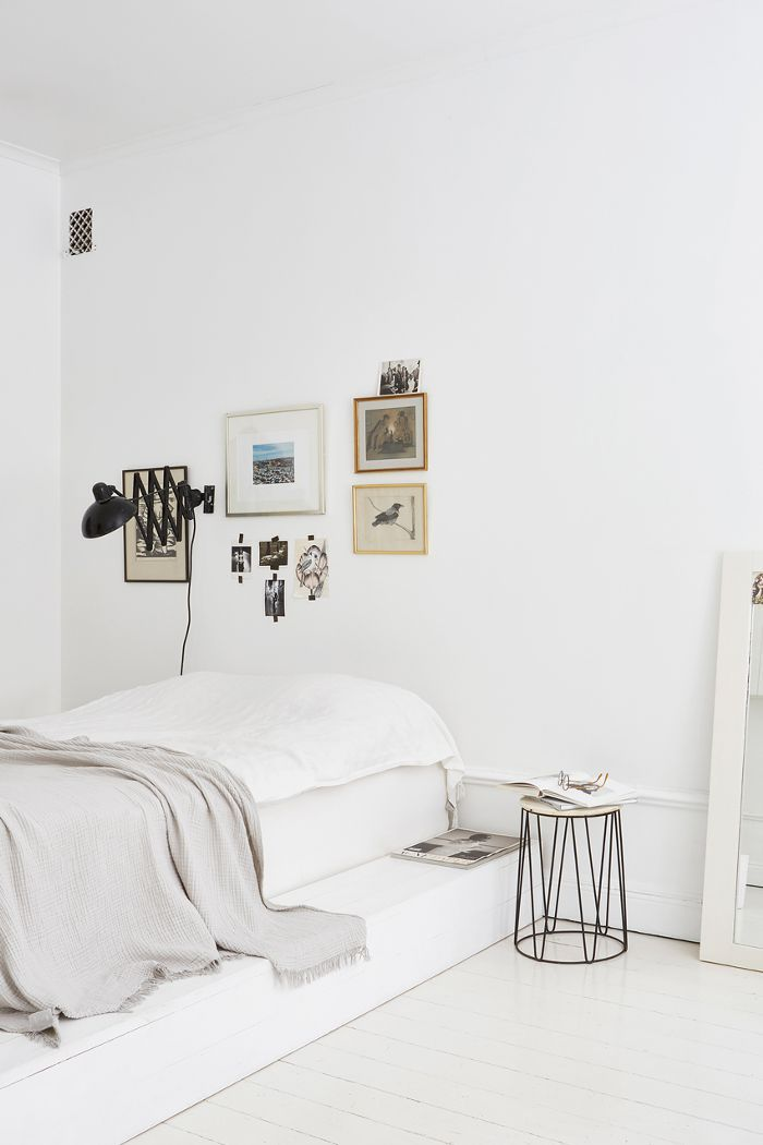 Framed photography in a bedroom with neutral color palette