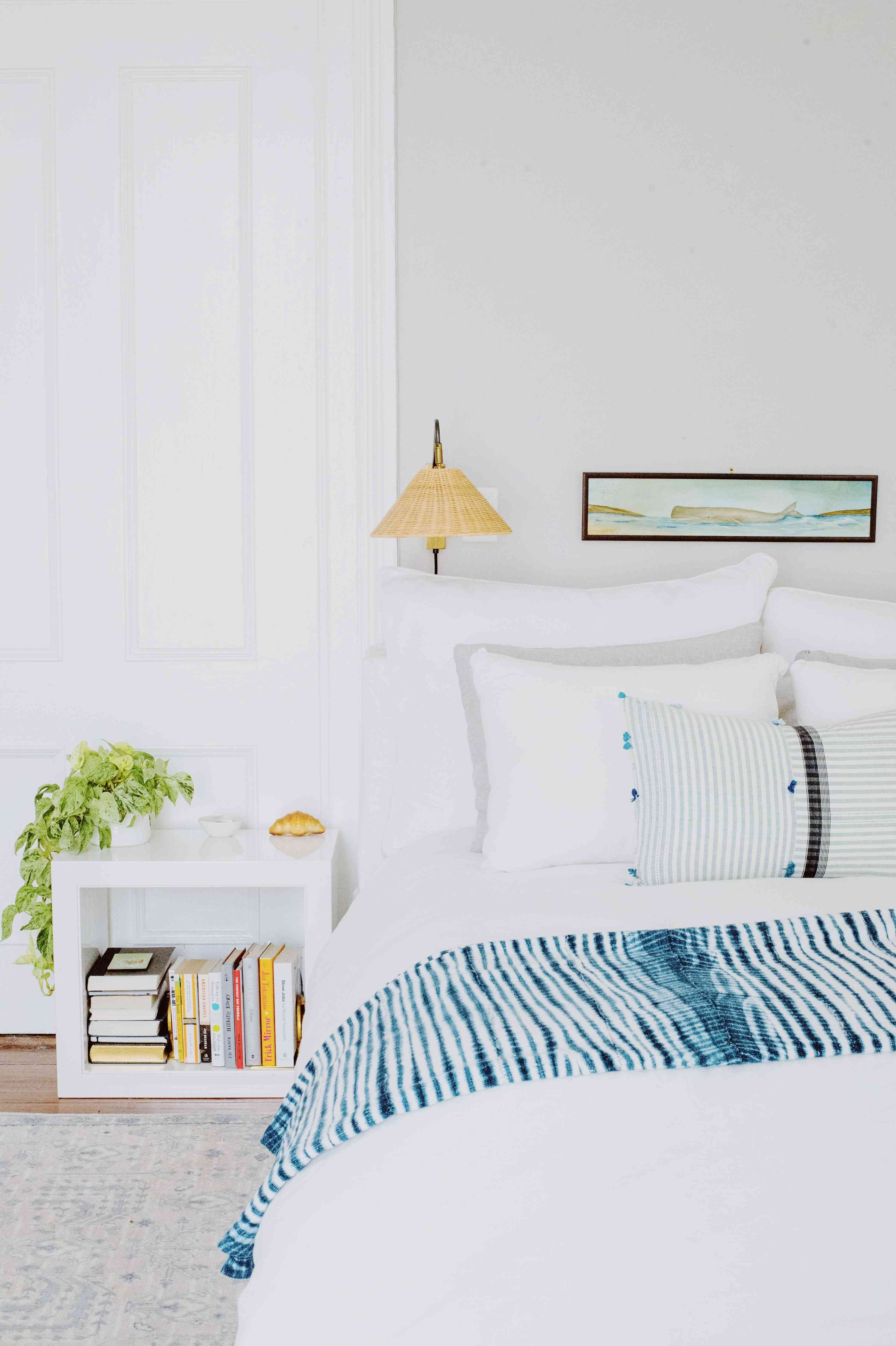 Amanda Greeley home tour - bedroom with white sheets and side table
