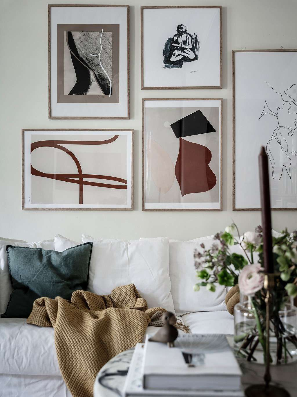 Cozy and chic living room with a gallery wall behind a white sofa