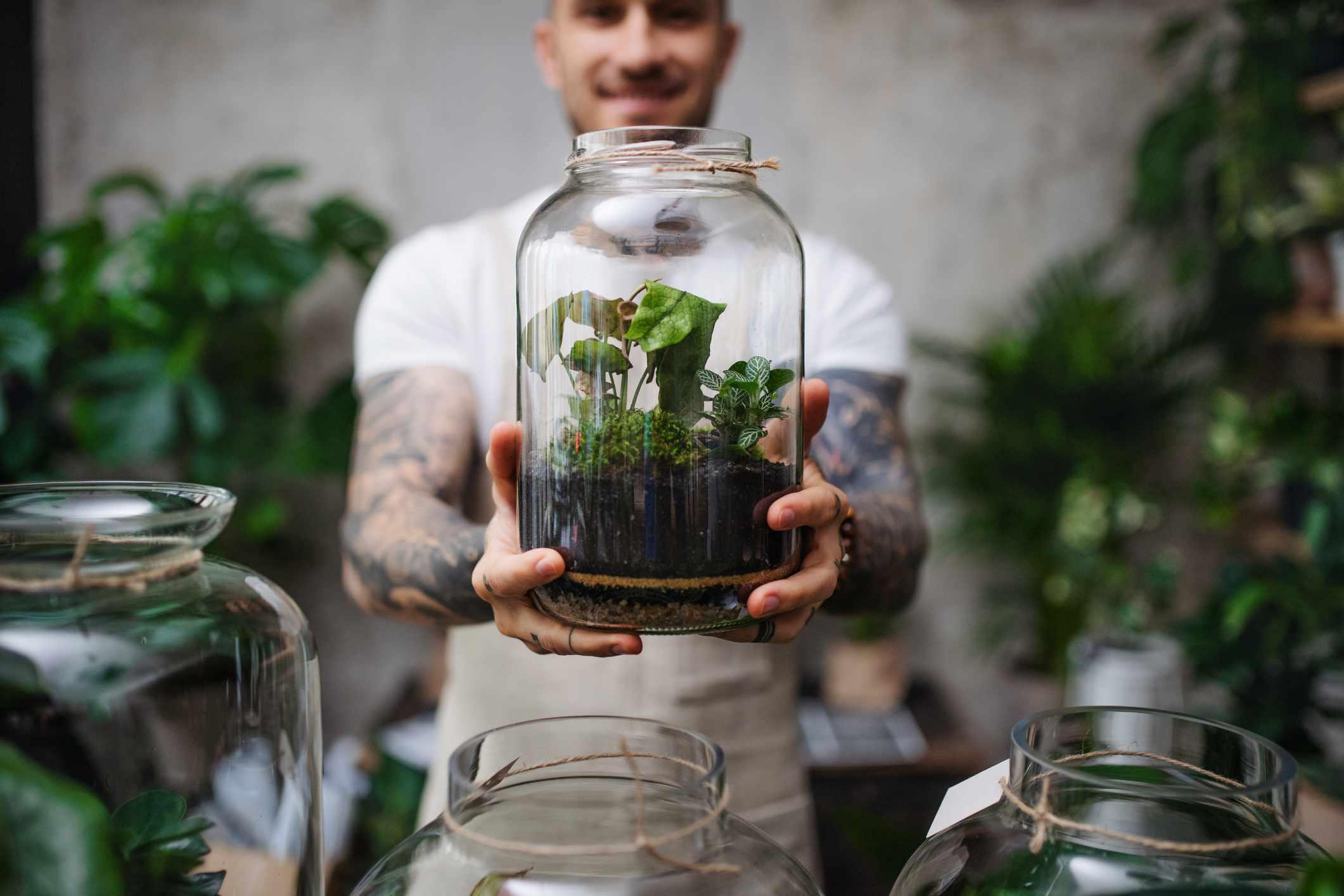 Man hold up terrarium
