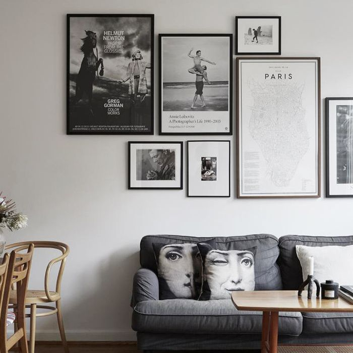 Gray living room with gray sofa and wooden coffee table