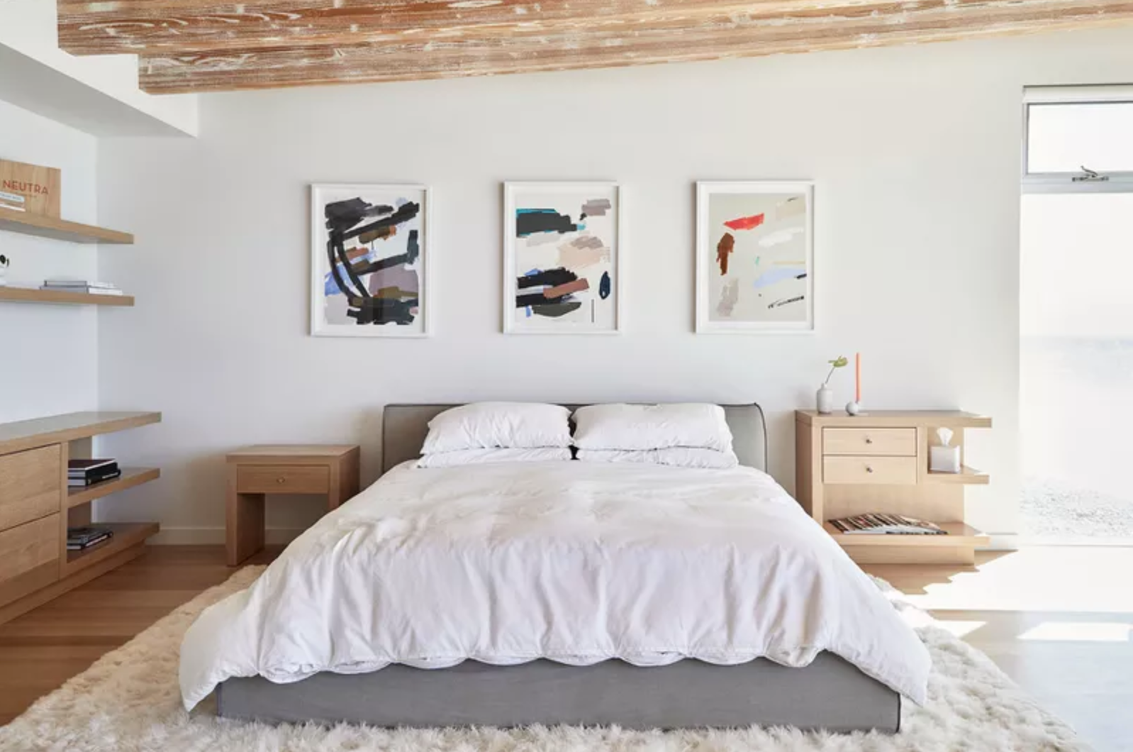 Modern bedroom with all-white bedding