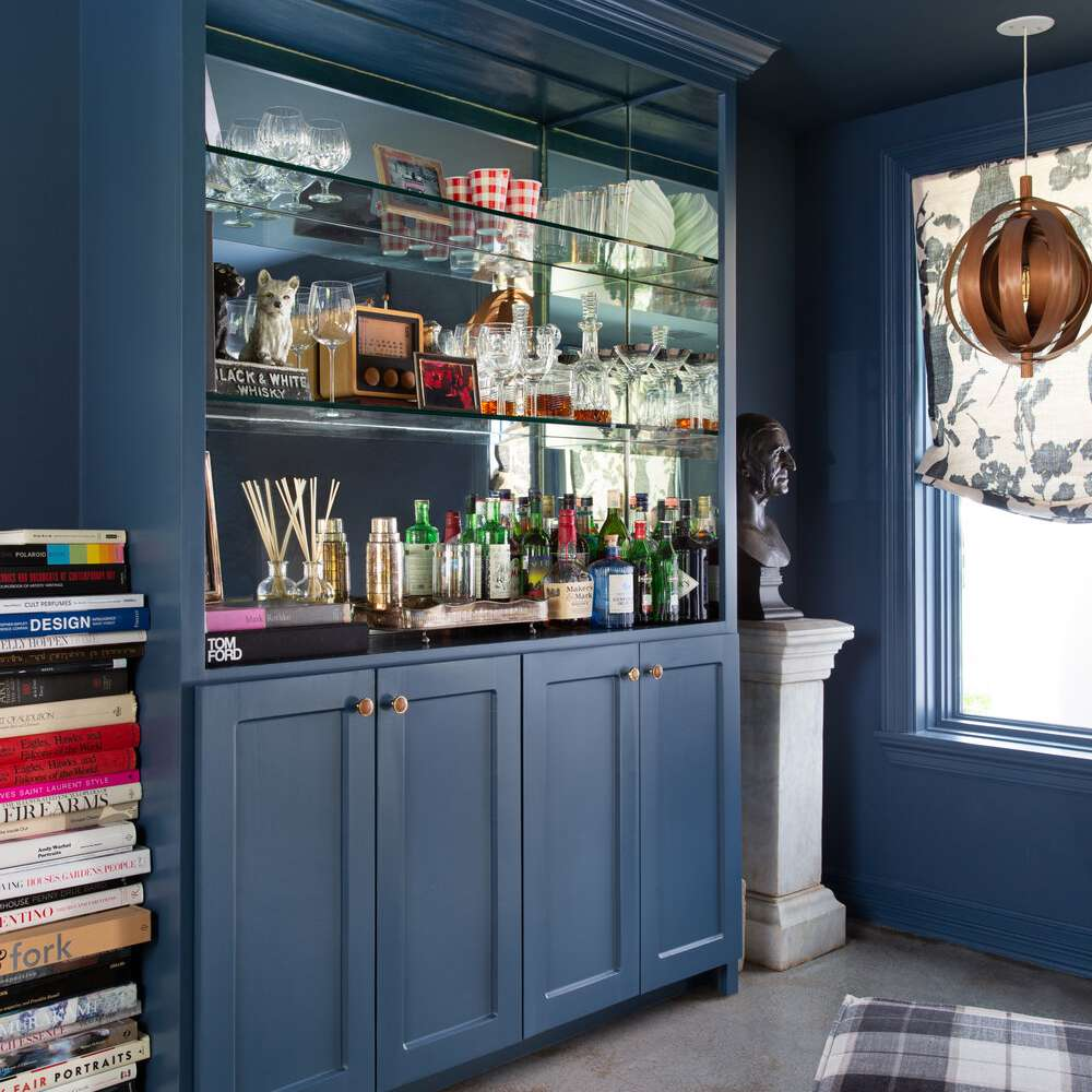 Bookcase dedicated to holding bar essentials