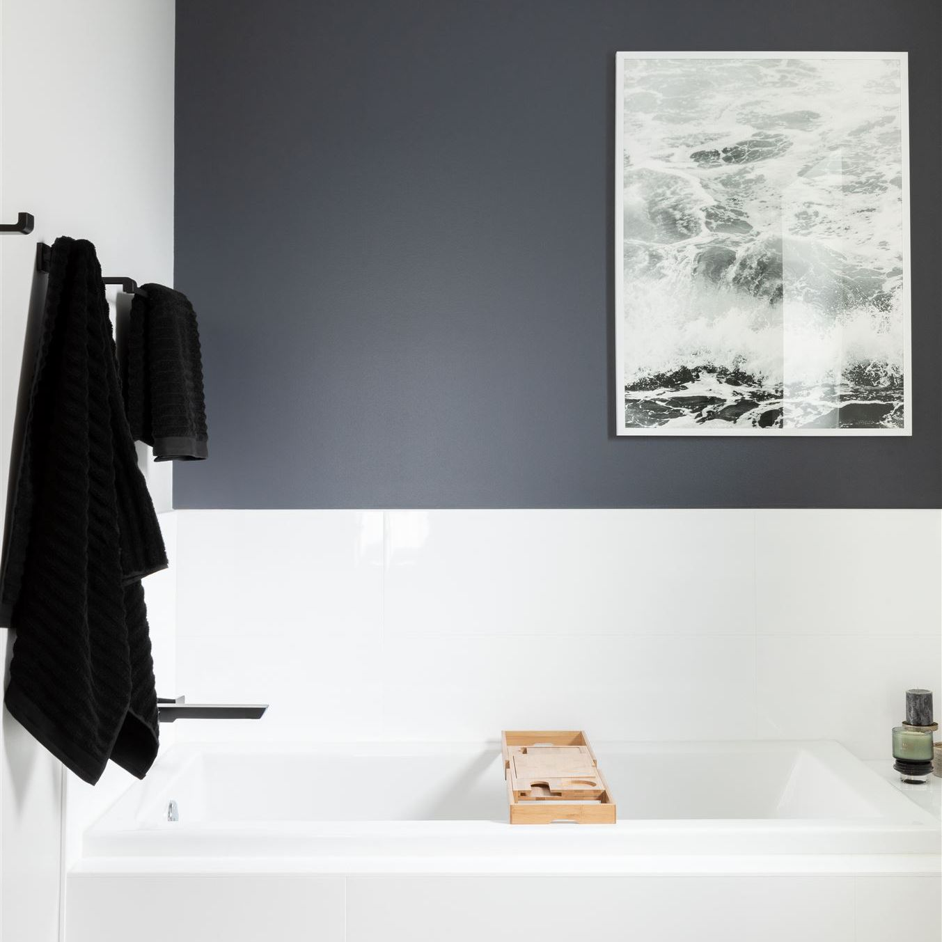 A bathroom with a black, white, and charcoal color palette