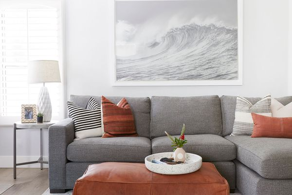 Beachy living room with gray sofa.