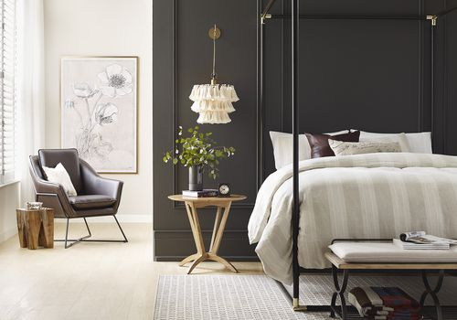 bedroom with dark bronze wall and white nook area
