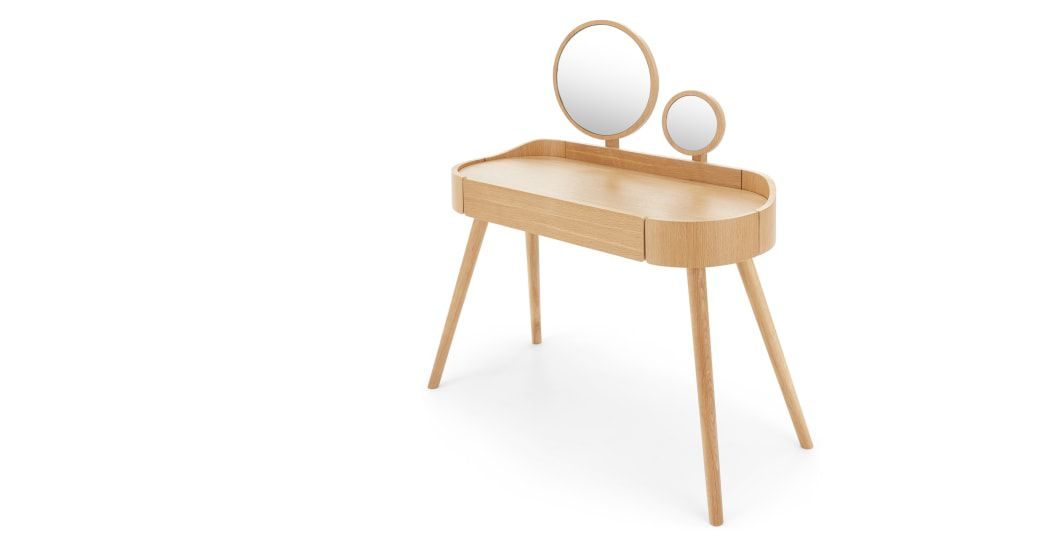 A light-wood midcentury-inspired dressing table with two circular built-in mirrors.