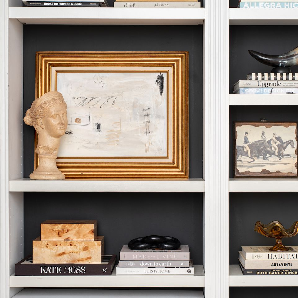 Book shelf with black, white and gold accents.