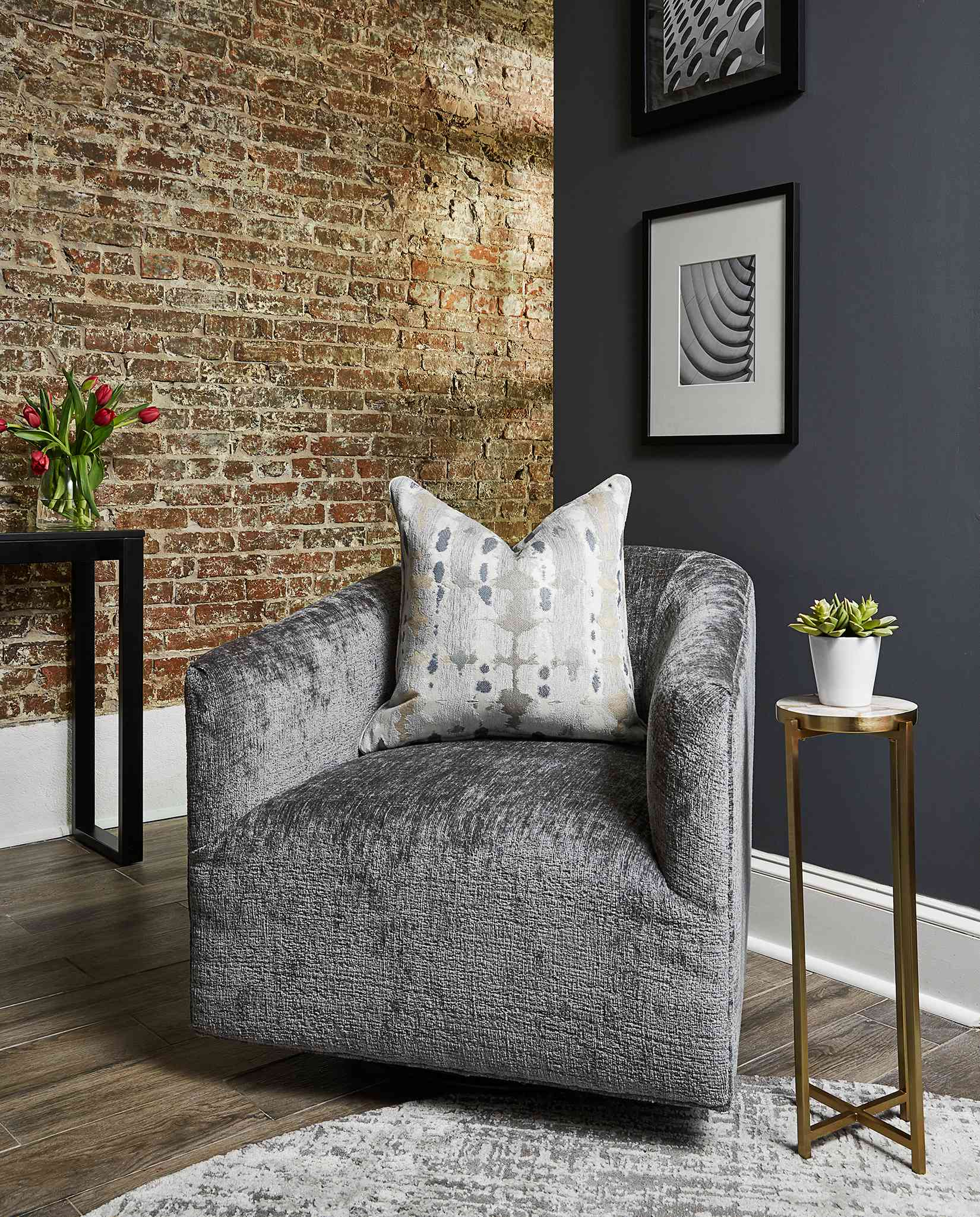 Duke Ellington home tour - cozy reading corner with an oversized chair and brick wall