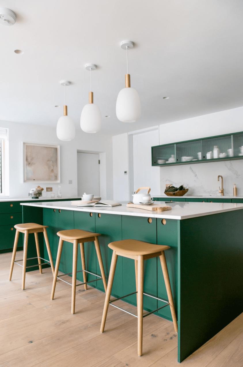Green kitchen with marble backsplash