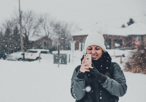 Woman outside in snow