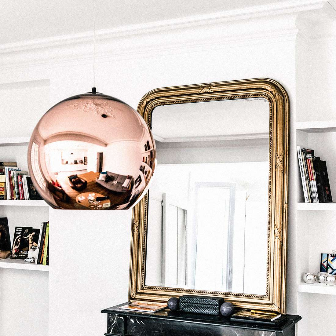 Vintage gold mirror about marble fireplace mantel.