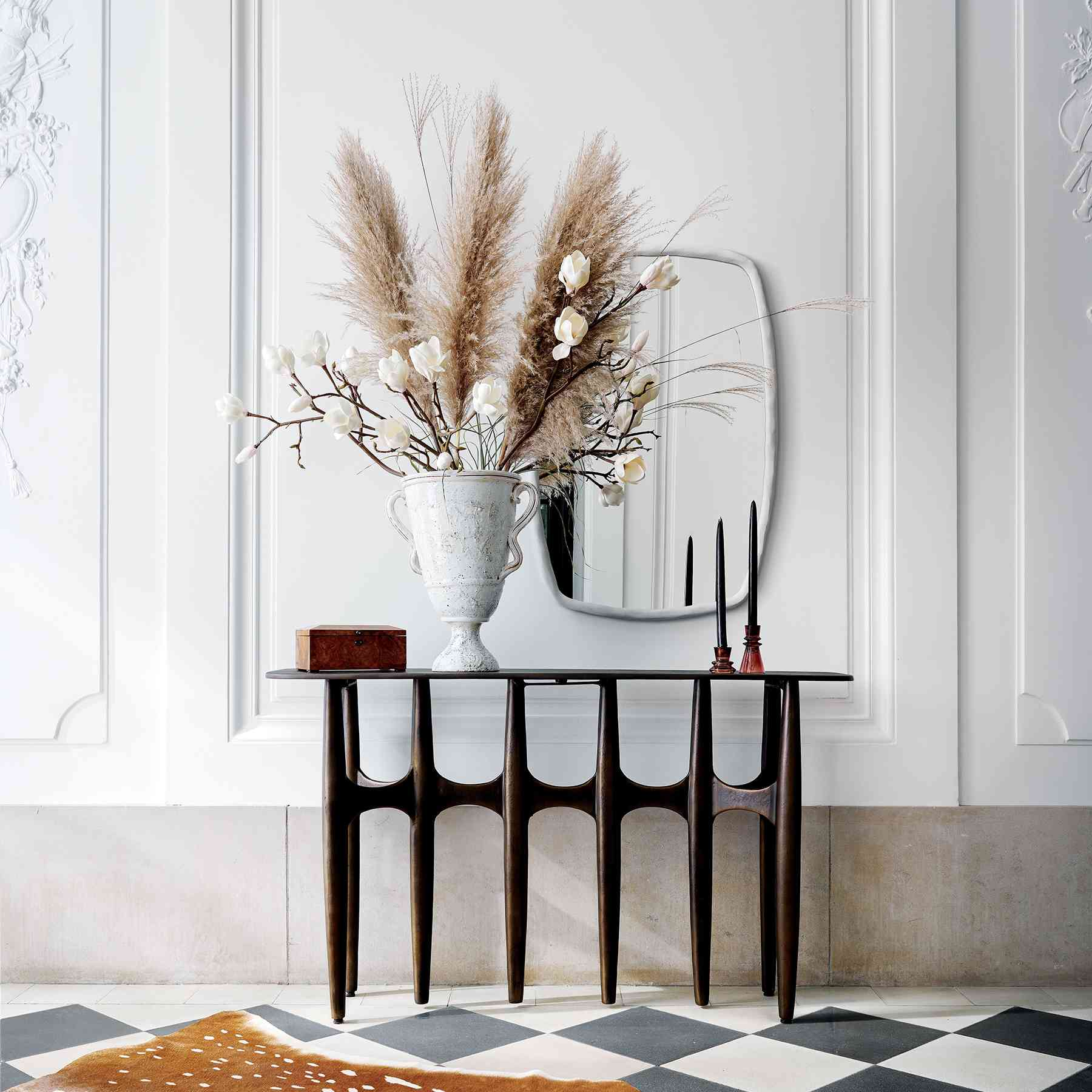 CB2 2021 Design Trends - console table with mirror and oversized dried florals