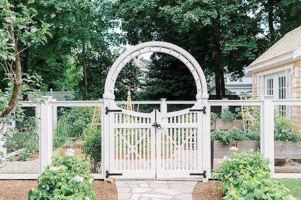 White garden gate leading into garden.