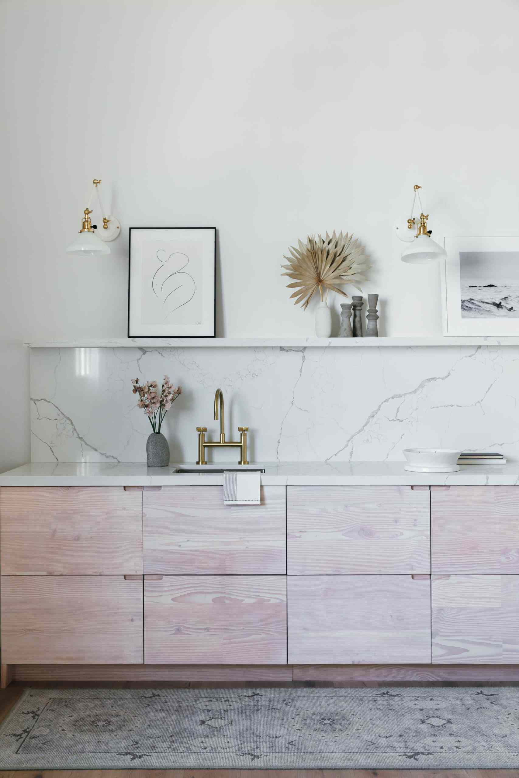 All white kitchen with marble-look counter and backsplash