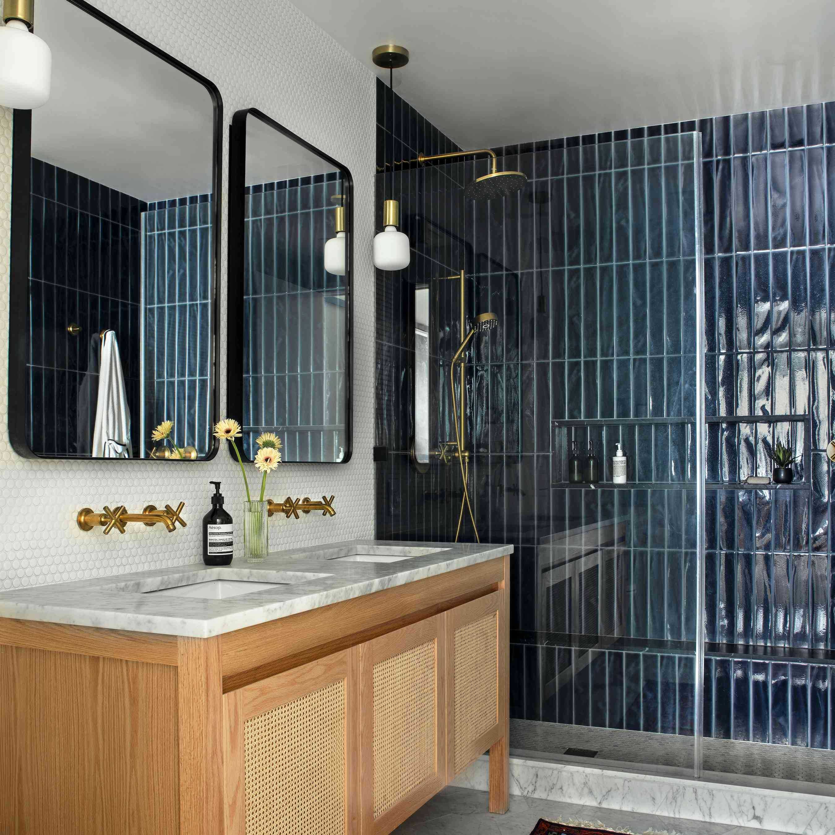 Bathroom with shiny blue tiled shower.