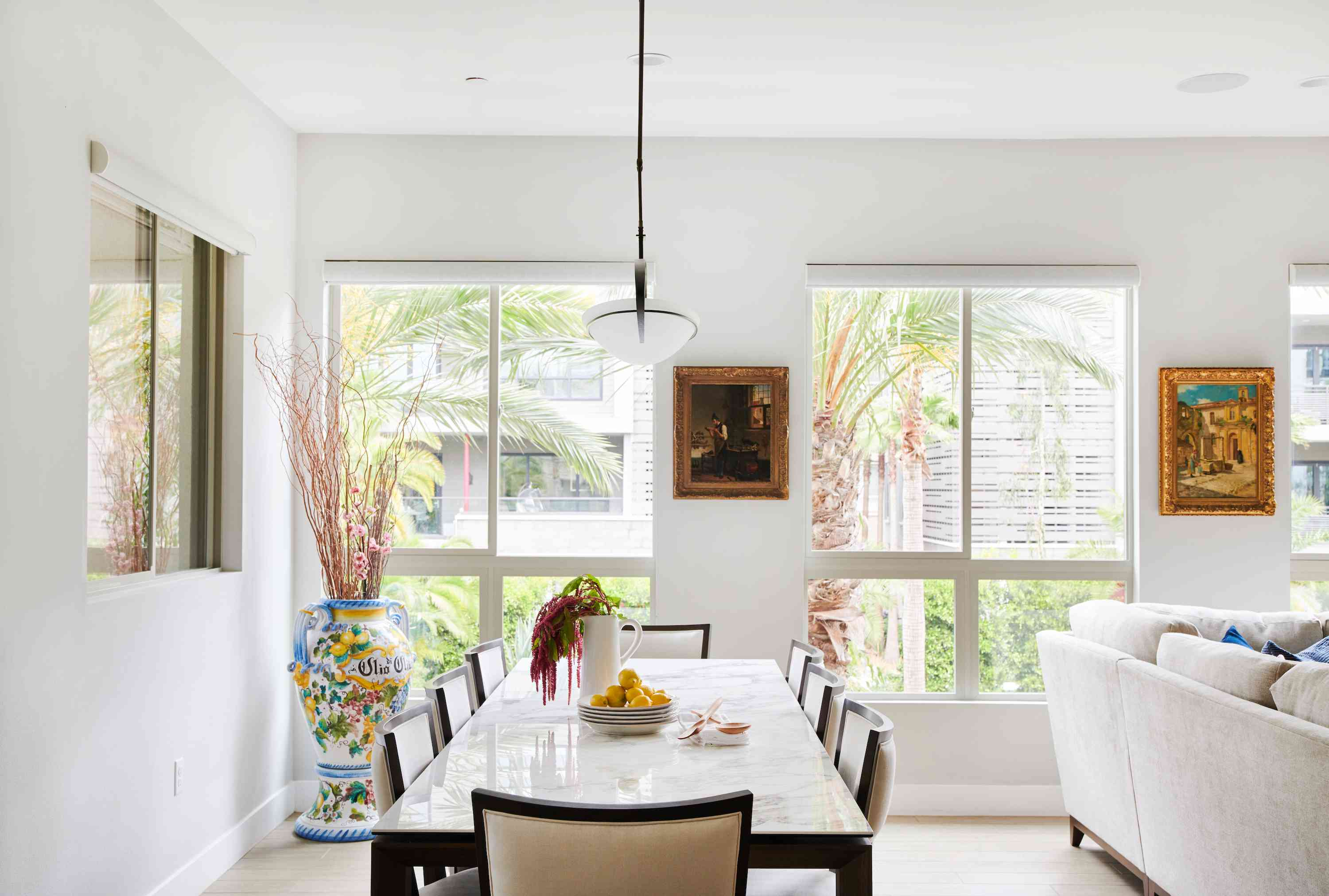 Open and bright dining room space with pendant light.