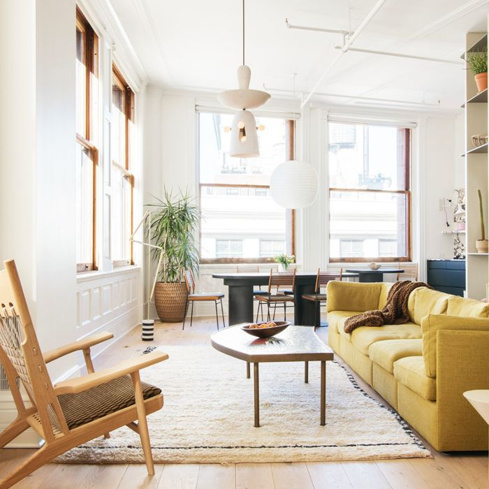 a living room with a mustard yellow couch