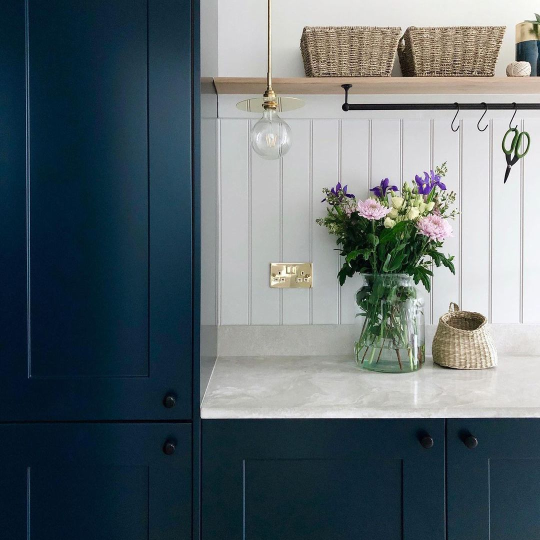 Blue kitchen with light countertops