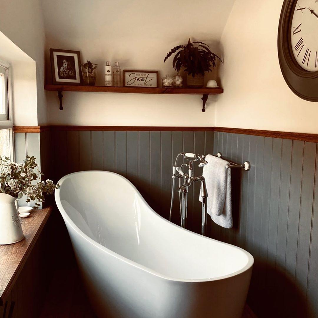 Bathroom with wainscoting and deep tub